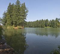 Lake and surrounding wilderness. - stock photo
