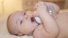 little boy drinks water - stock footage