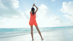 African American girl carefree on tropical beach barefoot - stock footage