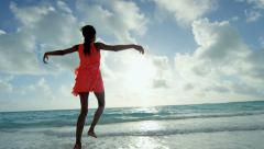 Luxury resort ethnic female in red dress on sand barefoot - stock footage