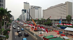 Jakarta street with MRT construction site Stock Footage