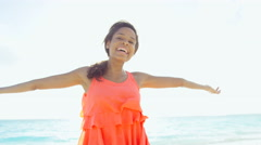 Leisure lifestyle of ethnic African American female on ocean beach - stock footage