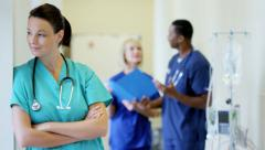 Portrait of professional pretty Caucasian female hospital staff wearing scrubs - stock footage