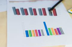 Graphs and pen - stock photo