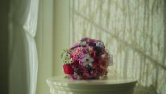 Beautiful bridal bouquet on the table. Wedding day. Bride's bouquet. - stock footage