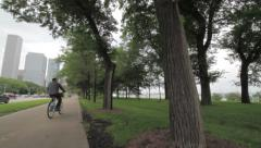 Bike Path in the City next to Trees, Street Stock Footage