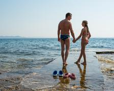 Happy family. Father and daughter enjoying summer time near the sea - stock photo
