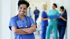 Portrait of senior African American female hospital staff wearing scrubs - stock footage