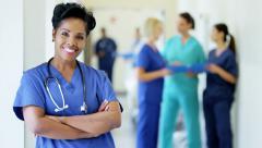 Portrait of confident African American female nurse in medical centre corridor Stock Footage