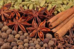 Heap of different dry spices (star anise, cinnamon sticks, allspice, cardamom Stock Photos