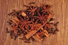 Star anise, cinnamon sticks and cloves Stock Photos