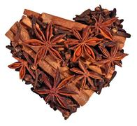 Star anise, cinnamon sticks and cloves in the form of heart on a white - stock photo