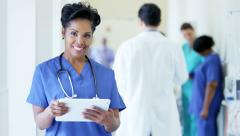 Portrait of African American female nurse using technology in medical center Stock Footage