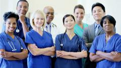 Portrait of confident teamwork multi ethnic male female staff doctor in hospital - stock footage