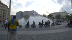 Relaxing by the fountain in Karlsplatz, Munich Stock Footage