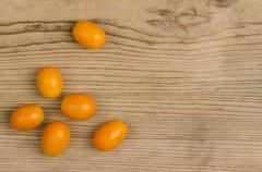 Oval Kumquats On Old Spruce Wood Board Stock Photos