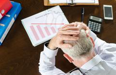 Falling down of economic activity - stock photo