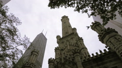 City Church Steeples Next to Skyscraper, Watertower Place Chicago Stock Footage