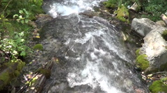 The fast flow of a mountain river in the rocks Stock Footage