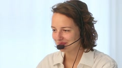Friendly and helpful young customer service operator at work - stock footage