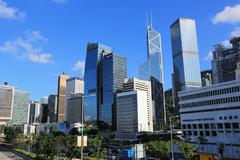 Hong Kong cityscape with victoria harbour and large group of tall buildings. Stock Photos