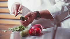 Close-up of chef hands cooking food in restaurant kitchen. Slow Motion. - stock footage
