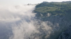Clouds move below rocks on the mountain Ai Petri, the Crimea Stock Footage