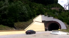 Cars entering a road tunnel Stock Footage