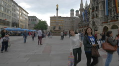Walking and waving in Marienplatz, Munich Stock Footage