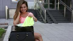 Young girl unpacking her shopping bags. Season of sales. Stock Footage