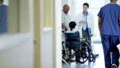African American couple female on wheelchair consult with doctor in hospital - stock footage
