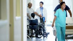 African American disabled senior female on wheelchair and husband in hospital - stock footage