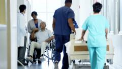 African American disabled senior male on wheelchair and wife in hospital - stock footage