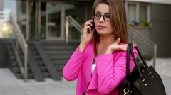 Young beautiful businesswoman writing a message on smartphone after work. Stock Footage