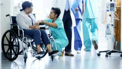 African American female nurse and patient on wheelchair consult in hospital - stock footage