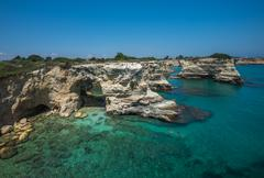Rocky beach in Puglia, Torre Sant'Andrea, Italy - stock photo