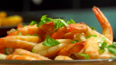 Delicious, appetising cooked shrimps & fresh basil plate, close up shot Stock Footage