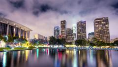 Downtown city Los Angeles skyline reflects in water at night. 4K UHD hyperlapse Stock Footage