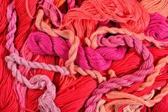 Colorful embroidery floss as background texture - stock photo
