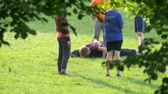 People wrestling in the park, Munich Stock Footage
