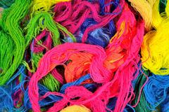 Stock Photo of Multicolored acrylic yarn as background texture