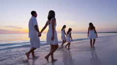 Barefoot Caucasian family wearing white clothes on the beach - stock footage