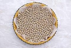 Ceramic beans in an uncooked pie crust Stock Photos