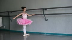 little ballerina puts on pointes  in the ballet hall - stock footage