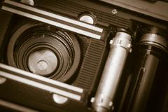 Inside with lens of old fashioned retro camera - stock photo