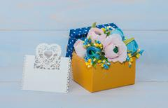 Decorative flowers in a gift box Stock Photos
