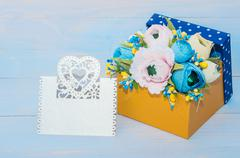 decorative flowers in a gift box - stock photo