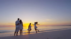 Barefoot Caucasian family wearing white clothes on the beach Stock Footage
