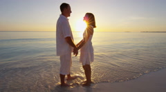 Caucasian couple barefoot on a beach together Stock Footage