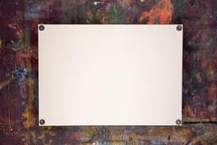 Sheet of watercolor paper pinned to wooden easel - stock photo